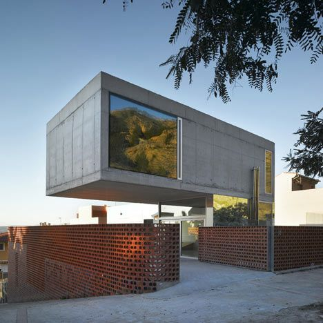 This project comprises two residences, with one cantilevered above the other.