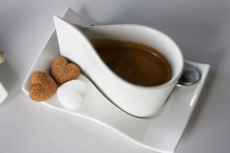 Coffee with brown and white sugar hearts