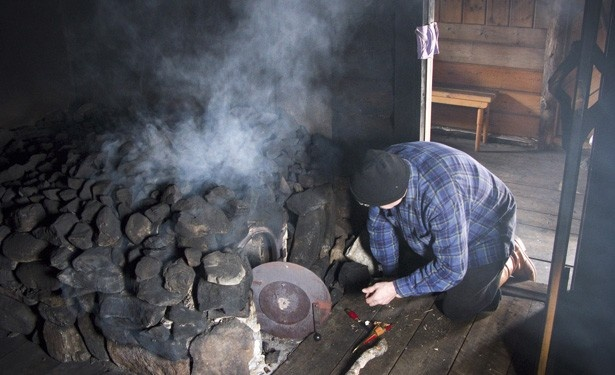 Traditional savusauna, consisting of an open fire under piled rocks and no chimney. After many hours a vent in the roof is opened and the soot is swept off the benches. It is the oldest type of sauna, with only a handful still operating worldwide.