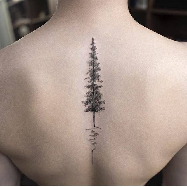Pine tree tattoo on the upper back. Tattoo artist:... - Little Tattoos for Men…