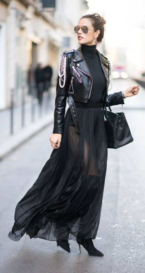 Snapped out and about in Paris, VS Angel Alessandra Ambrosio demoed how to winter-proof a sheer black maxi skirt: with a black turtleneck, a badass chain- and pearl-embellished moto jacket, and over-the-knee boots.