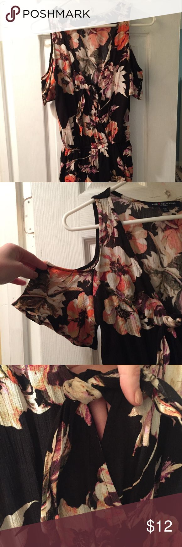 Black floral romper with front tie size XS Black romper (shorts) with off the shoulder sleeves.  The romper has only been tried on - never worn out of the house.   The front is low cut, with a tie closure one clothing Dresses Mini