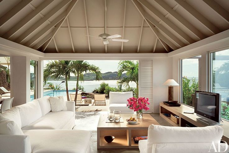 Journalist Dena Kaye, along with her partner, designer Dick Fallin, updated a house on St. Barts in the French West Indies. The couple, who designed the interiors, kept the furnishings light and understated in the living room. The sofa is from ABC Carpet Home. Photo: Peter Aaron/Esto
