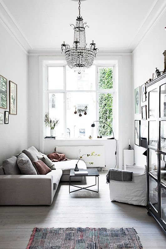 I like the comfy sofa and chair, modern and simple coffee table w/unusual crossed base - could live w/out the chandelier though