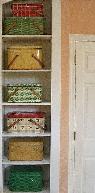 Lovely vintage picnic baskets. Cute for open storage and organizing! #closetorganizing