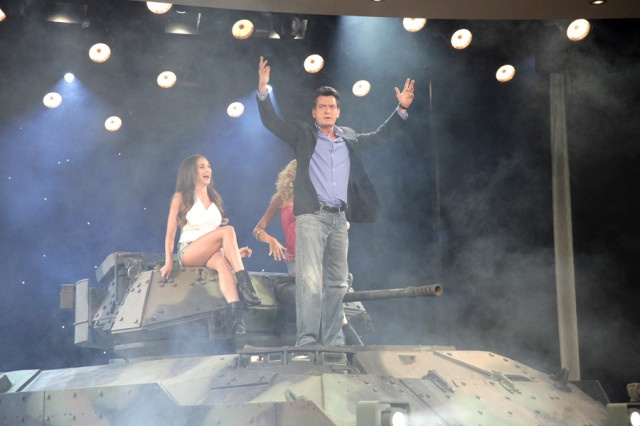 Charlie Sheen Makes An Epic Entrance In A Babe-Filled Tank