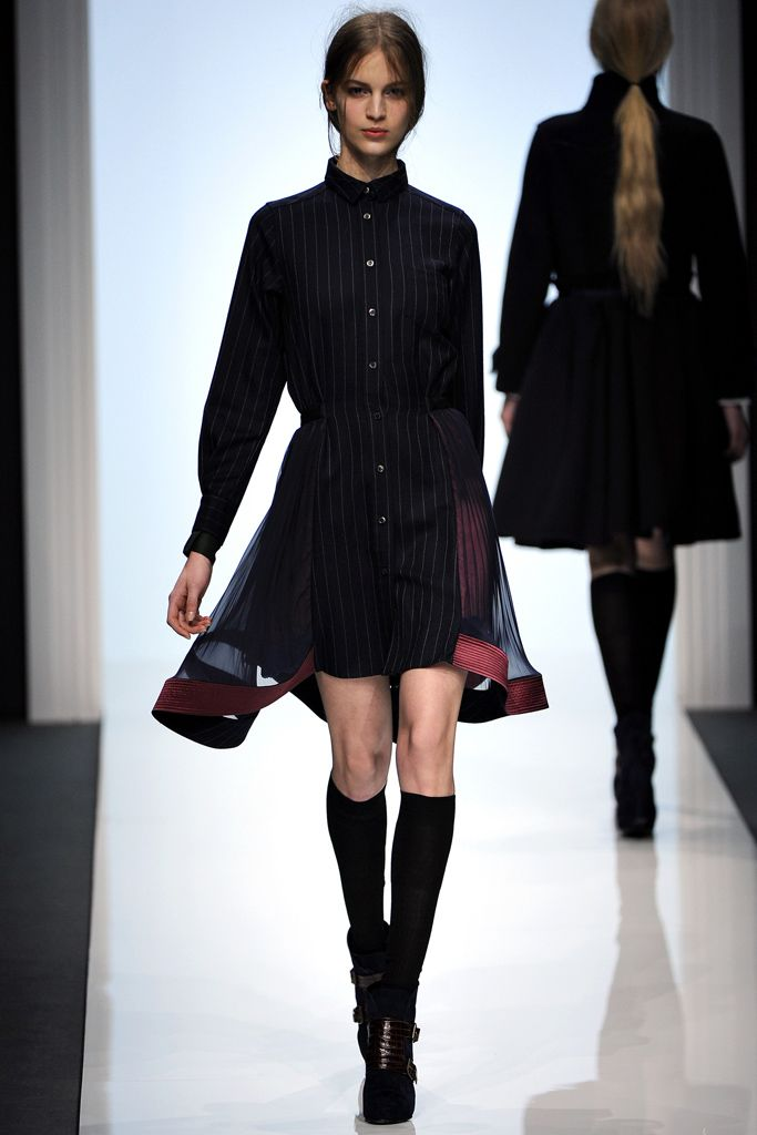 Got to love this one too button up stripped shirt/dress with mandrin collar paired with knee high socks and black shoes amazing.#PFW#F/W2012#RTW
