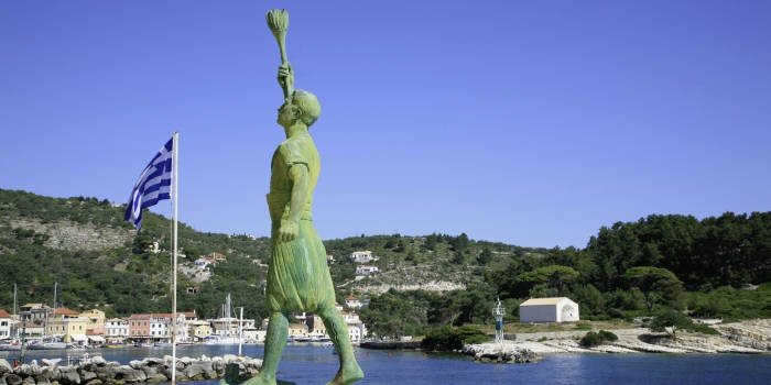 Statue of Georgios Anemoyiannis at the entrance of Gaios Harbour