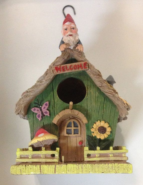 Geocache Container Gnome House by CachingCousins on Etsy.  I like how big it is.
