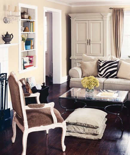 Placing furniture close together creates an intimate atmosphere.  I love this look.  It makes me relax just looking at it :)