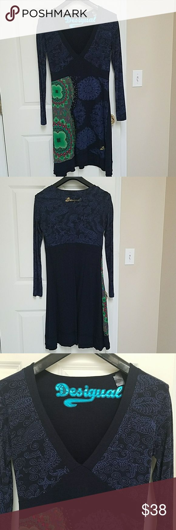 """Desigual long-sleeve dress Desigual long-sleeve v-neck dress. Reposh--great condition. Size runs smaller due to European sizing. Euro XL = USA L. 17.5"""" from armpit to armpit. 42"""" from shoulder to hem.   No Trades. Lowball offers will be ignored or declined. Thank you. Desigual Dresses Long Sleeve"""