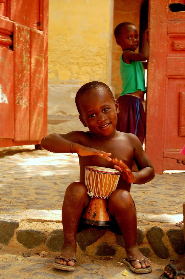 learning to play the djembe from an early age, very cute...Senegal | © angela biesot