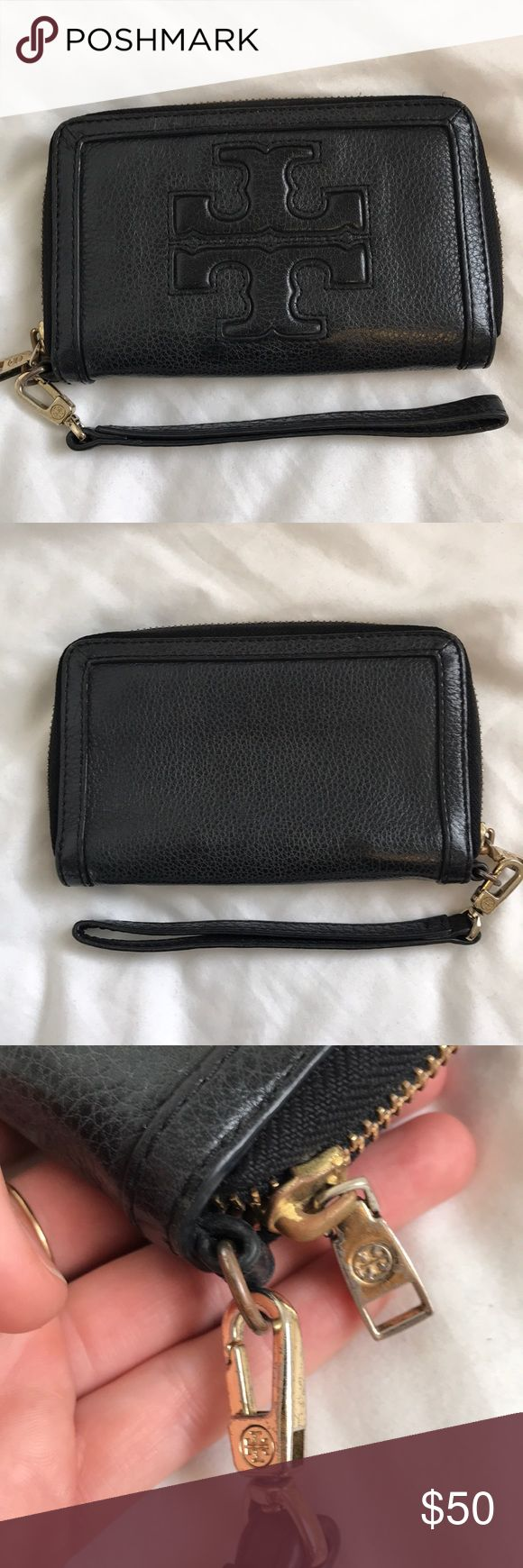 Tory Burch wristlet wallet, black pebbles leather So useful! Great condition besides the scratching on the exterior hardware (pictured) Tory Burch Bags Clutches & Wristlets