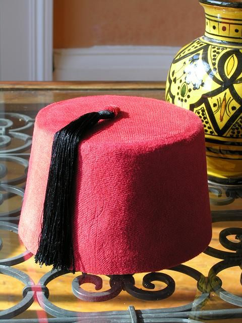 Fez hat. http://www.maroque.co.uk/showitem.aspx?id=ENT00877&p=01570&n=all