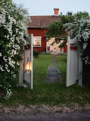 Exterior / Landscaping / Inspired by: White flowering vines, narrow stone walkway, white gate, red barn-style building