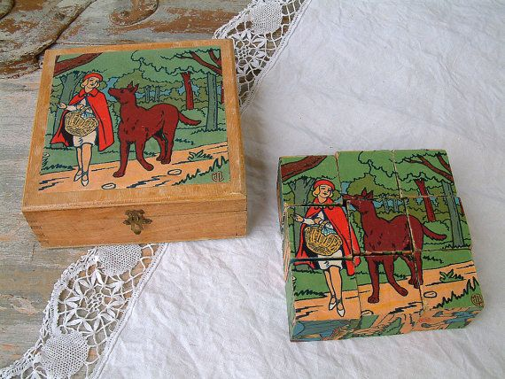 French vintage wooden blocks puzzle game. 6 puzzles in 1. Childrens wooden puzzle blocks in wooden box. Childrens stories. Fairy tales