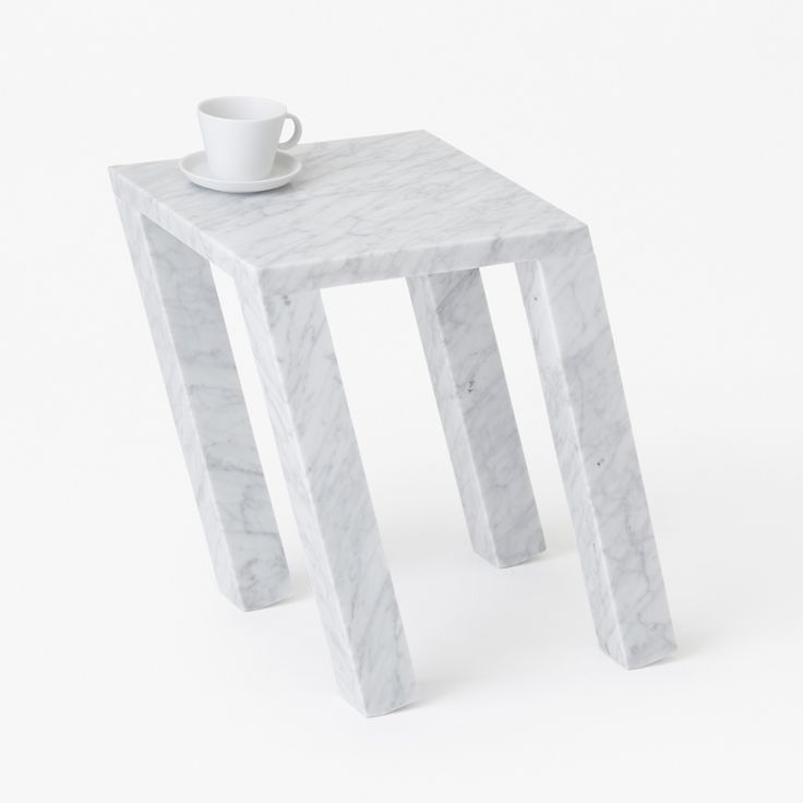 These marble side tables by Japanese design studio Nendo look like they are leaning over