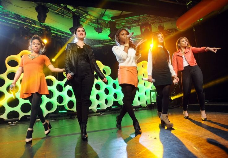 All together now. The ladies of Fifth Harmony harmonize during a performance at iHeartRadio's Nick Radio launch on Oct. 24 in New York: Photo