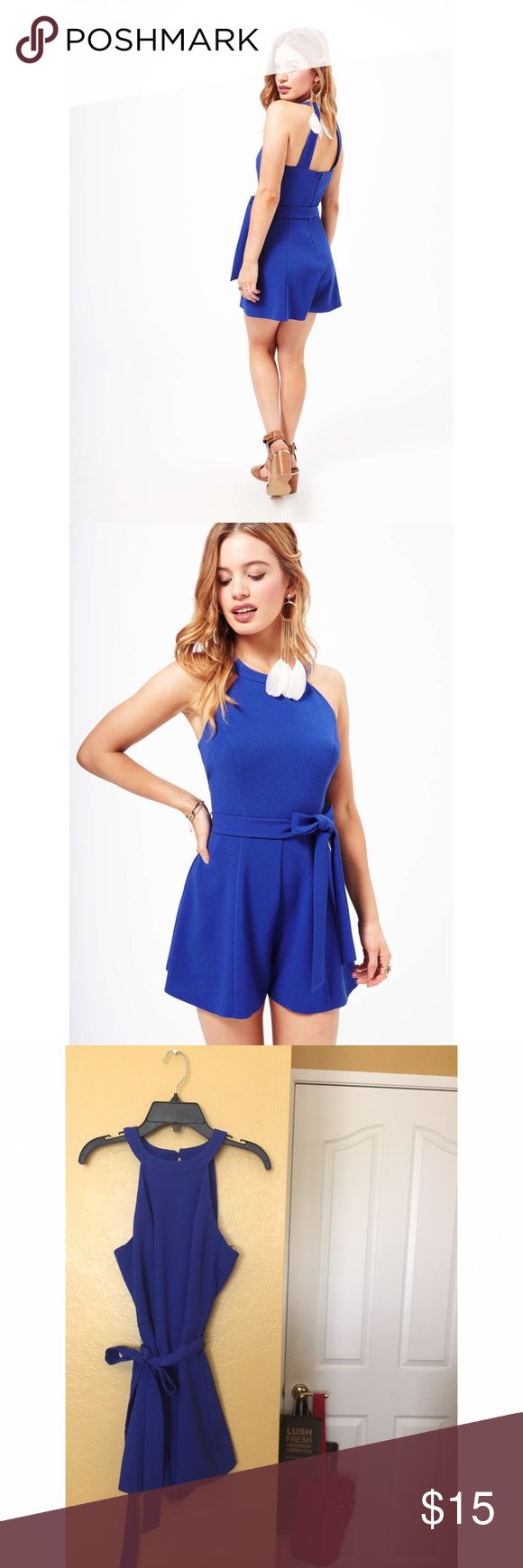 Miss Selfridge Petite Blue 90's Playsuit Romper The lightweight fabric and flippy short style legs make this petites blue playsuit a winner for the summer! Team with sandals to complete the look. Zipper back. Detachable waist tie. One zips of the clasp is coming loose (as pictured), just needs to be sewn down. In excellent used condition. No modeling or try on's. Miss Selfridge Pants Jumpsuits & Rompers