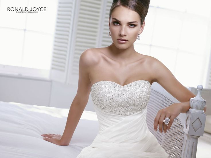 Ronald Joyce Irma Size 10 & Under Reduced by 40%! Chiffon ruched sheath style wedding gown. Bust is beautifully adorned with diamantes and pearls.   www.timelessbridalwear.ie
