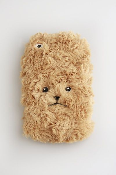 This fuzzy little guy is the cutest phone case we have ever seen.