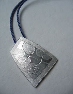 MARIANNE BROWN-CANADA.-Meadow Rue Pendant - silver, on hand wound adjustable length silk cord