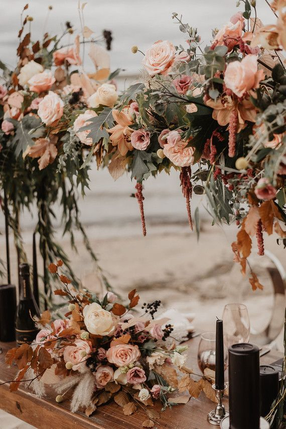 This moody fall wedding table scape complete with beautiful shades of rust and c…
