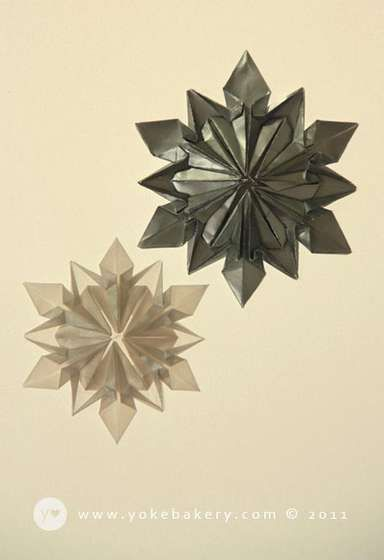 Origami snowflake origami snowflakes and bakeries for How to make a real paper snowflake