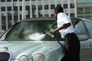 How is professional detailing with steam cleaning methods different than regular car wash?