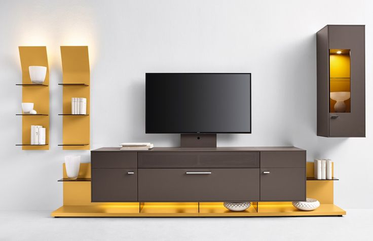 flexible Wohnwand Media Concept   Hier wurden die Farben Gelb und Taupe gewählt, welche im Zusammenhang eine modische und geschmackvolle Mischung ergeben. #yellow #livingroom #MoebelLETZ