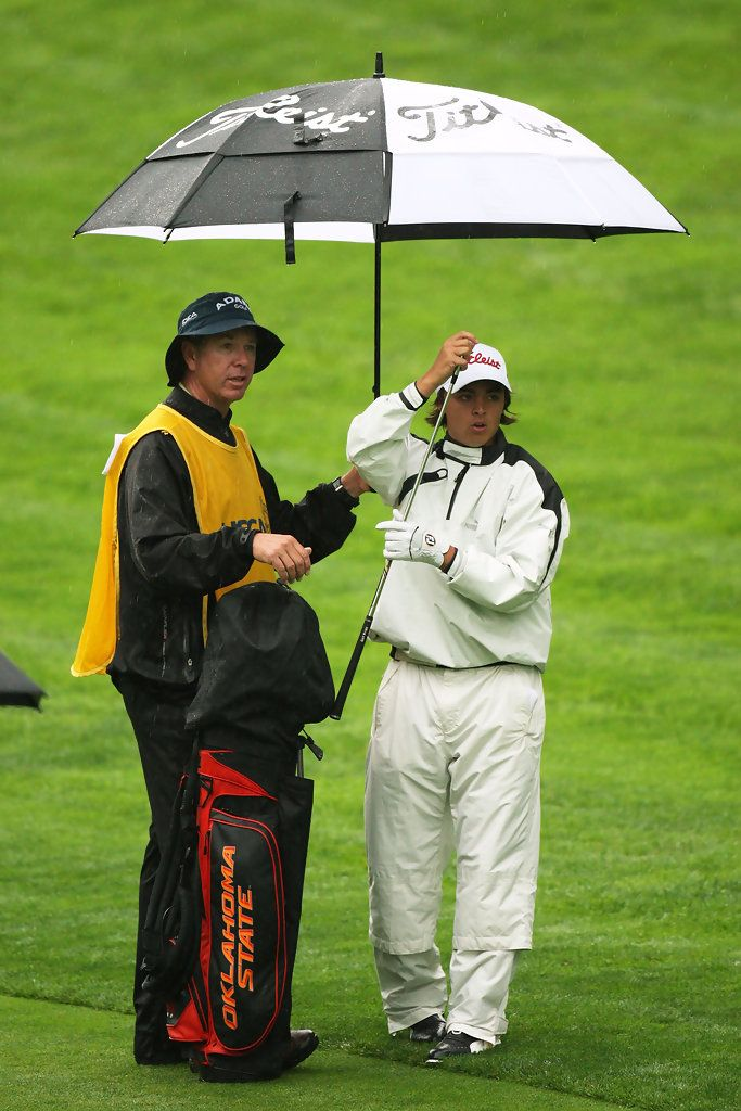 Amateur Rickie Fowler waits with his caddie Graeme Courts on the second hole during the first round of the 109th U.S. Open on the Black Course at Bethpage State Park on June 18, 2009 in Farmingdale, New York.