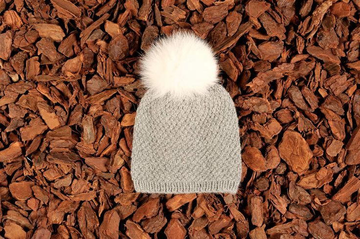 Knitted beanie in greay alpaca wool with a fur tassel. Natural materials and handmade in Denmark.