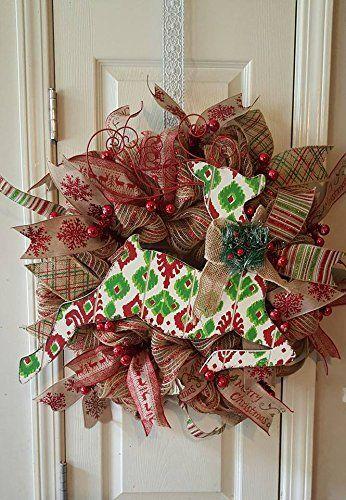 Christmas Burlap Reindeer Wreath. Christmas Reindeer wreath made of burlap mesh, ribbons and a wooden reindeer.