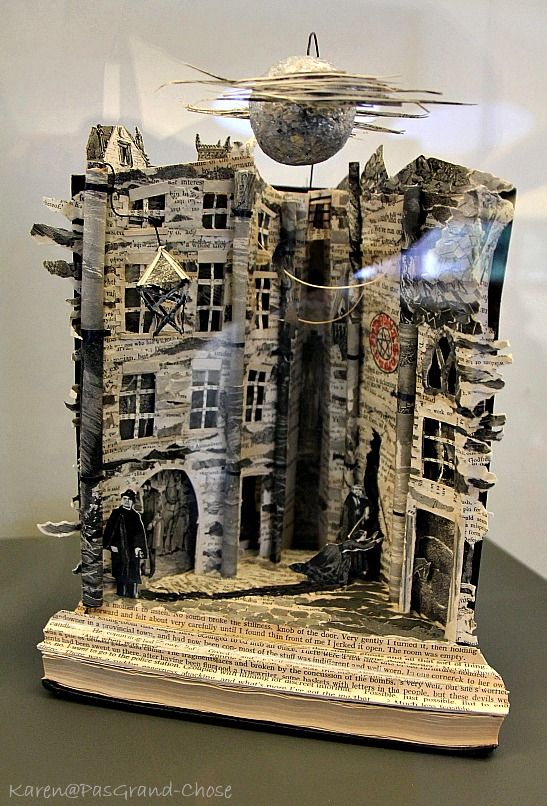 Staff at the Writer's Museum discovered this street scene under a silvery moon, crafted in the opened-out spine of a copy of Ian Rankin's Hide and Seek...Check out the blog post to see all of the paper sculptures left anonymously in Scottish museums and libraries.  What a wonderful thing to do.