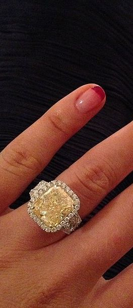 """Happiest Day #Isaidyes,"" Iggy Azalea captioned the first photo of her yellow diamond engagement ring that's made from over 10 carats!"