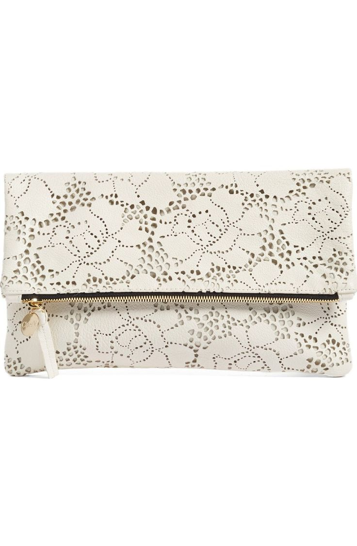 Intricate perforations create a lace-like pattern atop this classic fold-over clutch that works for either formal or casual occasions.