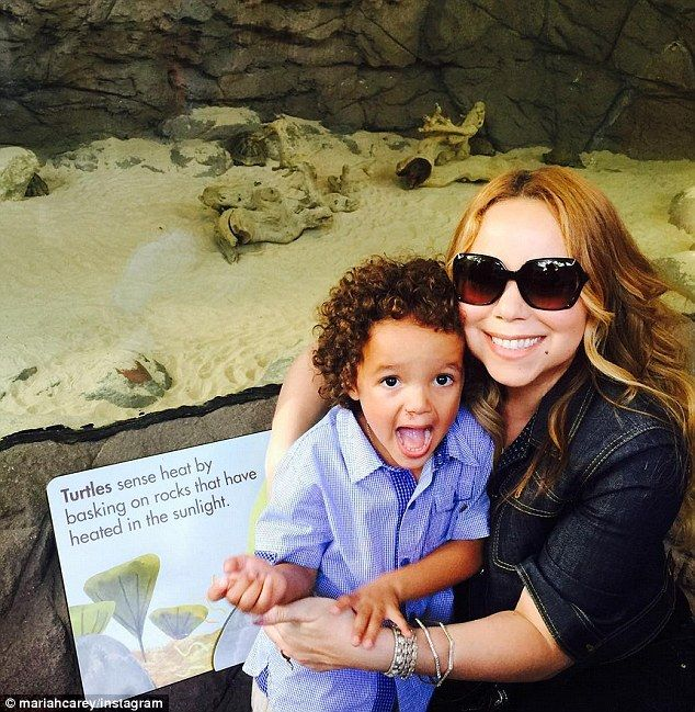Family day: Singer Mariah Carey and her son Moroccan, who appeared thrilled with his trip to the Bronx Zoo