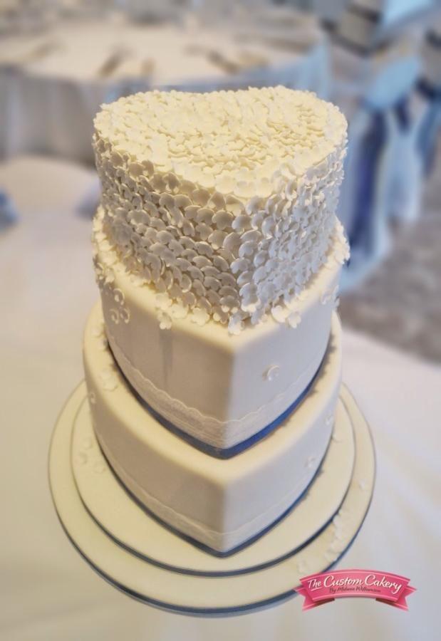 Ivory Heart Wedding Cake by The Custom Cakery - http://cakesdecor.com/cakes/212352-ivory-heart-wedding-cake