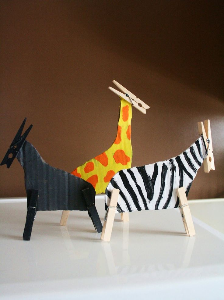 Use cardboard and clothes pegs to make safari animal models.