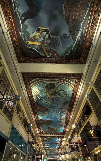 The ceiling of the Piccadilly Arcade, off New St. These paintings are like looking up from underground into an apocalyptic post-war world. I've already spent hours on them and don't understand them. They are exciting, frightening and beautiful. There are about 6 in total in a timeline. It was painted by a contemporay artist called Paul Maxfield and is entitled 'A Life In The Year Of The Chinchillas'.