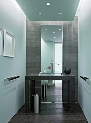 modern bathroom, pale blue paint, dark gray linear tile