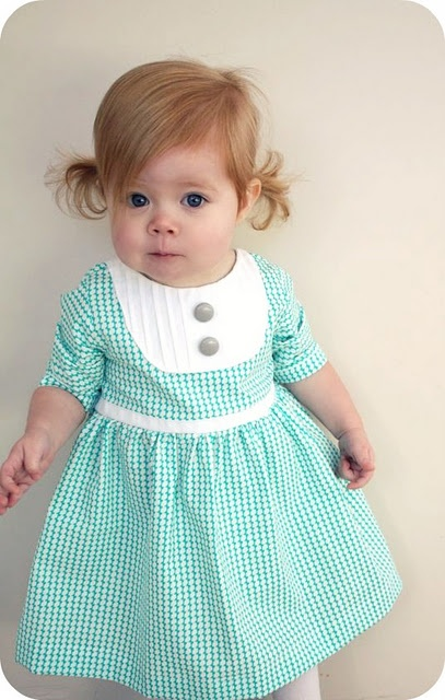 Lovely dress and adorable baby model. Great tutorial on making this dress.