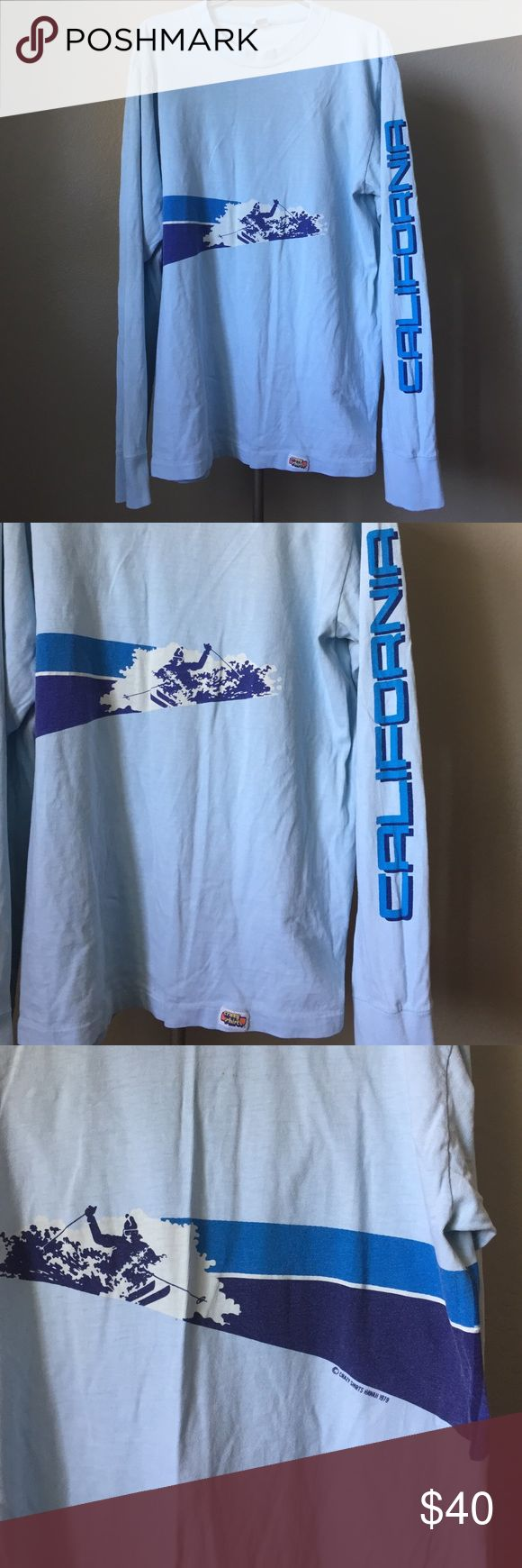 """Rad Vintage California Ski Long sleeve t-shirt Just in time for ski season this shirt is absolutely rad! Vintage from 1979 from Crazy Shirts Hawaii 1979. California screams down the left sleeve with a skier shredding in the front and back. Size is Large28""""l x 21""""chest. Crazy Shirts Shirts Tees - Long Sleeve"""