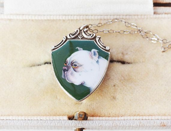 This is a very rare antique sterling silver hand painted bulldog enamel charm. I believe this might be a unique portrait of someones beloved dog, custom painted, like a crest! :) Love the expression on the dogs face :D Would make a great gift for a bulldog lover. The enamel is green,