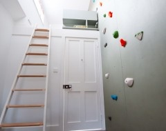 ladder to loft and rock wall