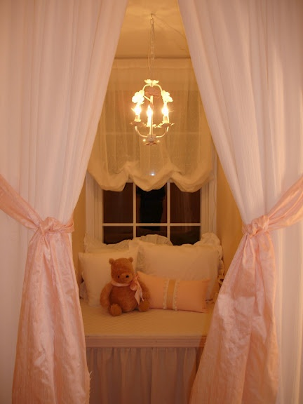 curtains make an adorable nook in a dormer
