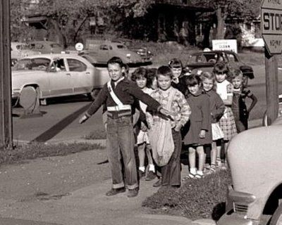 back in the day when a 7 year old not only knew how to cross the street, he could be responsible for the rest of the class too.