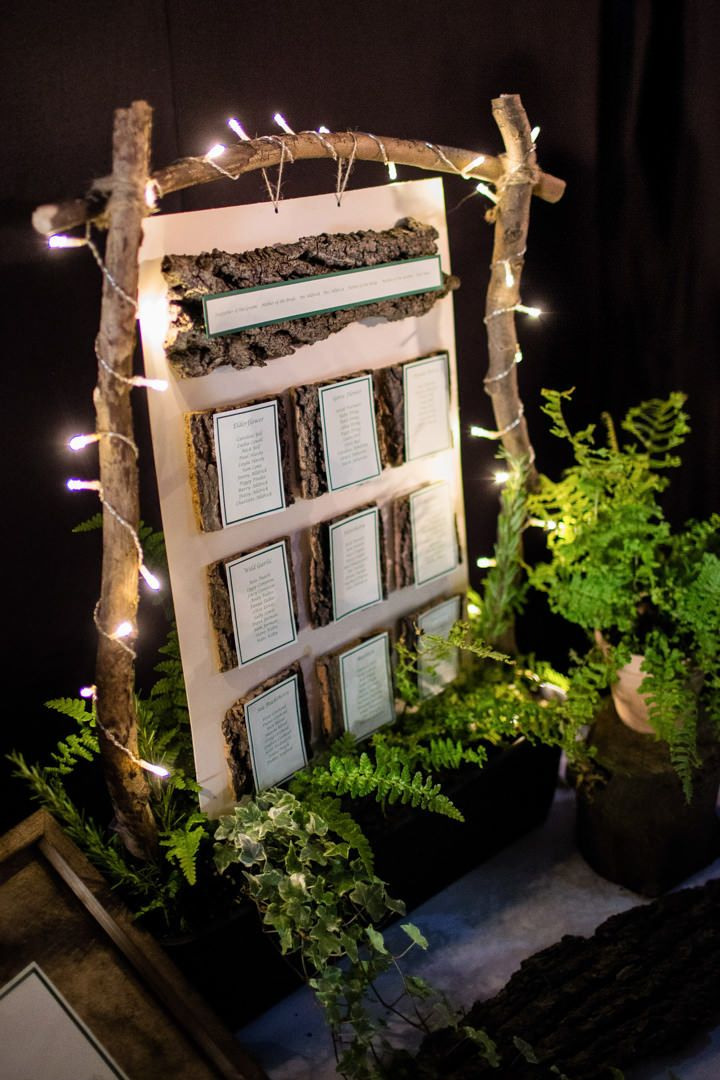 Seating plan arranged on pieces of bark, highlight a woodland theme. www.lucabella.co.uk
