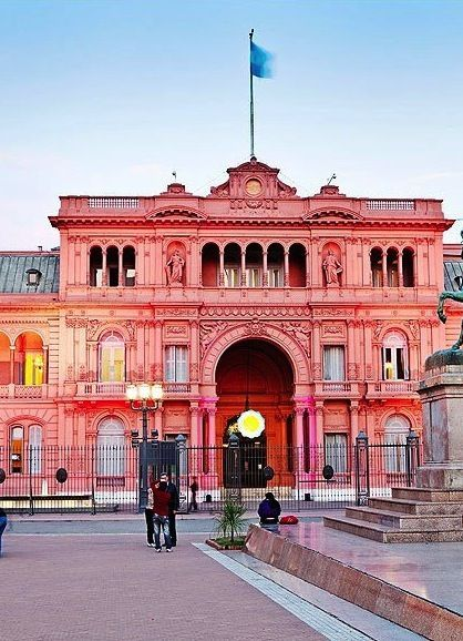 Visit the Pink House (La Casa Rosada) in Buenos Aires. Stay for the street performances & market stalls (check out the mate sets) in the square.