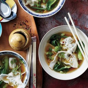 Chicken-Watercress Wonton Soup | MyRecipes Flecked with peppery watercress, these soft chicken dumplings make for a slurpy-good appetizer soup.